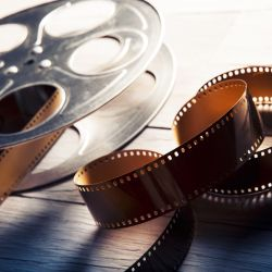 Image of a film reel and a film strip.