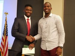 Kishawn Jean-Pierre, left, received the award from the 2016 winner, Stanley Fils