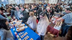 Crowd tries samples at more than a dozen stations at the March 19 food entrepreneurs event.