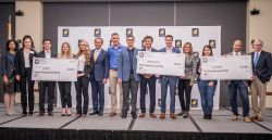 Student pitch contest winners with prize checks