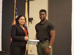 Student presents award to another student