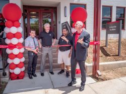 Facilities administation at ribbon-cutting ceremony