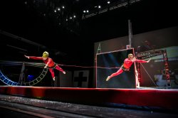 Tethered dancers performing in Streb production titled: TIED