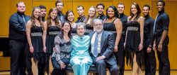 Photo of Christine Consales, Kay Consales and J. Douglas Peters (seated) with Musical Theatre and Vocal Performance majors of the John J. Cali School of Music who performed at the dedication ceremony under the direction of Professors Clay James and Gregory J. Dlugos.