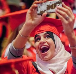 Student at graduation taking selfie