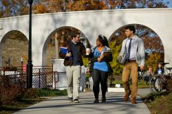 Students walking on path near Student Center courtyard