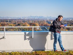 Student at Montclair State in the shadow of the NYc skyline