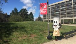 Designated Smoking Banner near Blanton Hall with Ciggy standing underneath it