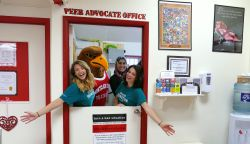 Three students and Rocky inside in the Peer Advocate Office