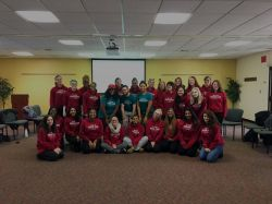 Group of Peer Advocates inside in red and teal shirts