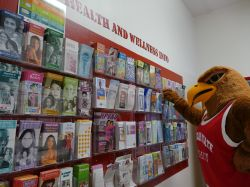 Rocky looking at a wall of health and wellness brochures