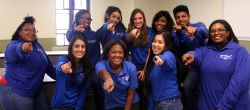 Group of students dressed in IT Service Desk blue shirt