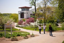Flowers and trees blooming around Alumni Green and Kasser Theater