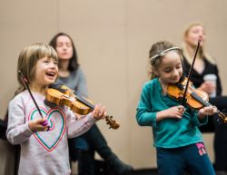 Child violinists enjoying themselves