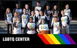 The staff of the LGBTQ Center standing on the steps of the Student Center.