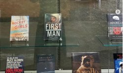 Titles on exhibit, including Rise of the Rocket Girls, First Man, etc.