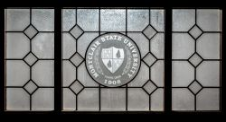 Photo of Montclair State Shield on a decorative window.