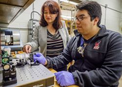 faculty shows student how to use gravitational wave detection equipment