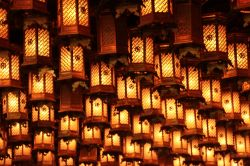 Some ancient lamps all lit up.