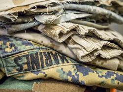 Photo of pile of military uniforms.