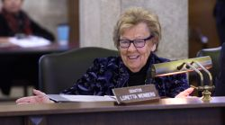 Senator Loretta Weinberg smiling while sitting behind desk.