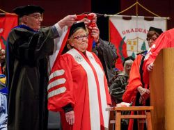 Photo of Senator Loretta Weinberg receiving honorary doctorate from Montclair State University Provost Gingerich at Graduate School Commencement.