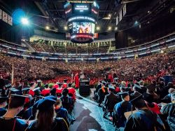 Photo from back of stage at Commencement at Prudential Center as graduates walk across the stage