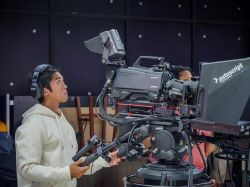 School of Communication and Media student operating Sony camera equipment.