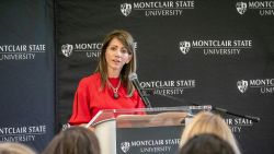 New Jersey First Lady Tammy Murphy at Montclair State University podium giving keynote speech.