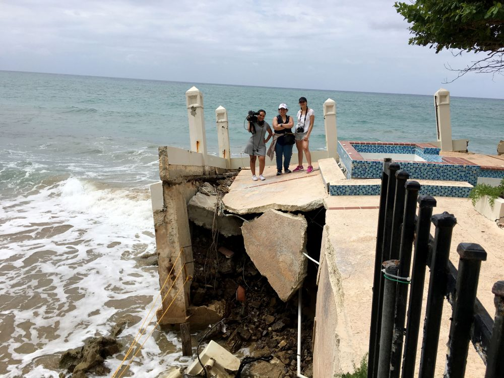 Students in Puerto Rico standing on pier before beach