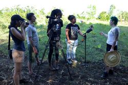 Student film crew in Puerto Rico interviewing female