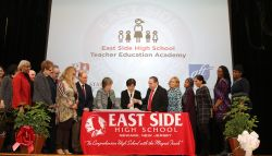 Dr. Susan Cole with other educational leaders on stage at East Side High School