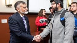 Ambassador of Pakistan to the United Nations, His Excellency Nabeel Munir, shaking hands with a student