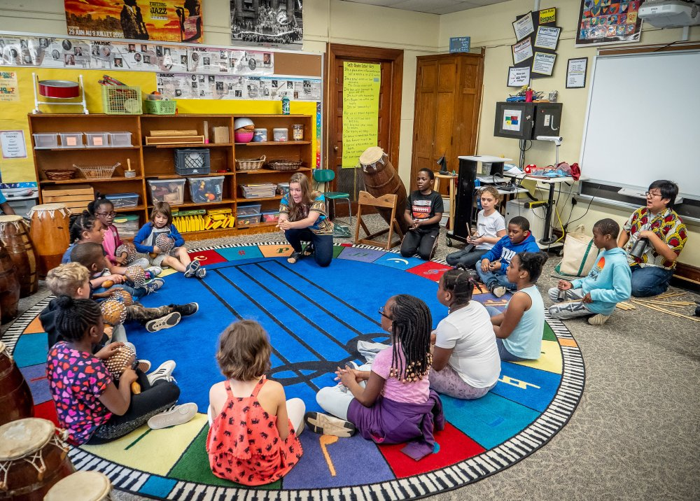 Monika Szumski leads West African music circle with third graders at Seth Boyden Elementary School