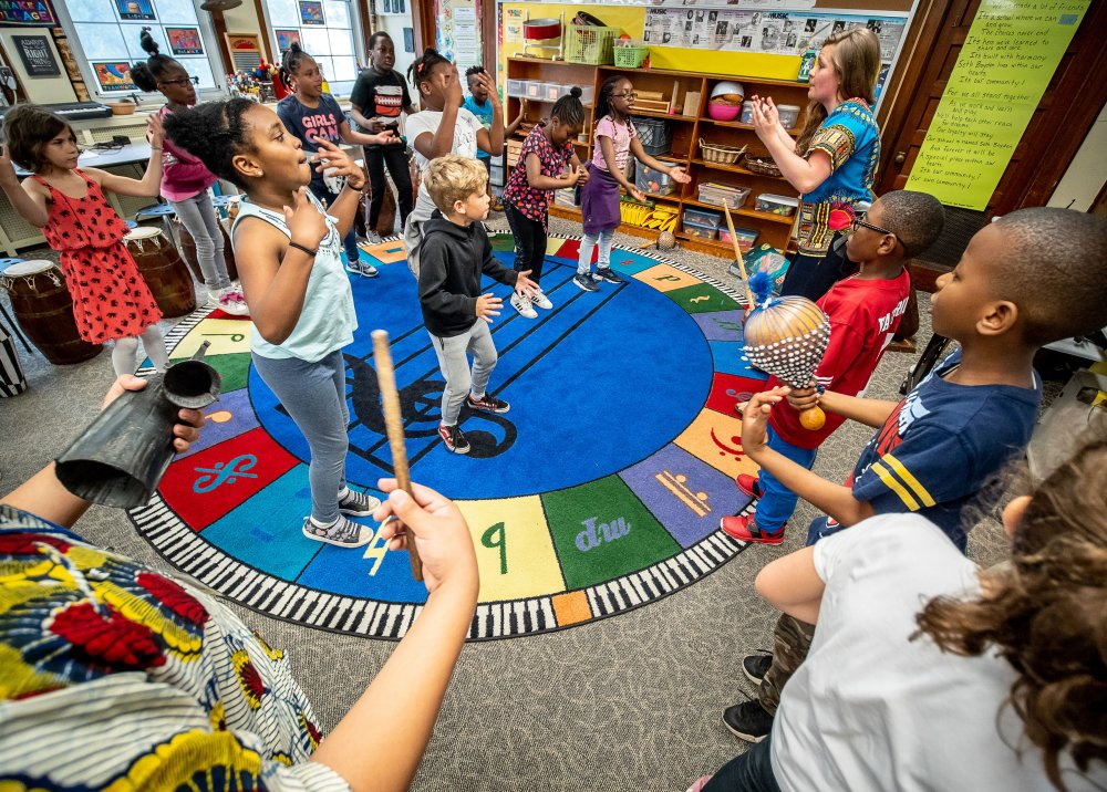 Monika Szumski leads West African music class with third graders at Seth Boyden Elementary School