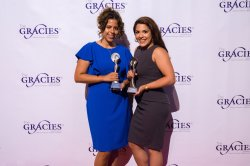 Laura Galarza and Krystal Acosta posing with their Gracie Awards