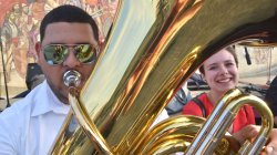 Musicians posed playfully with tuba