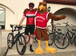 Andrew Scanlon with Rocky the Red Hawk