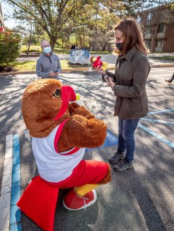 Rocky giving Mikie Sherrill a plush red rocky doll