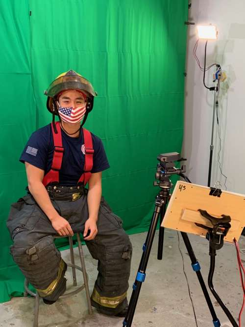 Firefighter being recorded in front of green screen