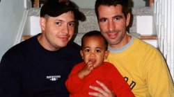 Peter Mercurio and Danny Stewart pose on stairwell with Kevin for family photo