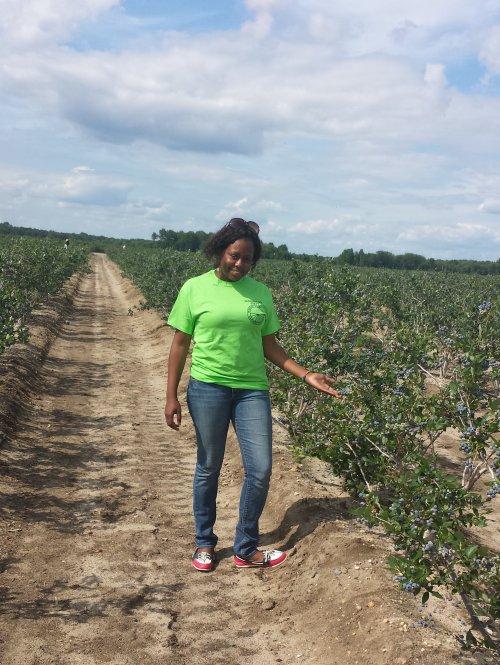 Guerline Pierre '11 in blueberry field.