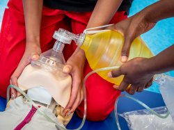 Closeup of nursing students hands during simulation assignment.