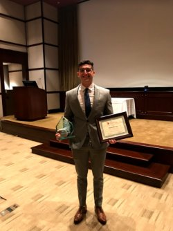 4-year BSN student Anthony Ghandour photographed receiving the Sodhani Family Scholarship.