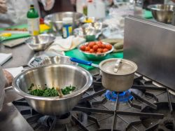 Photo of pot on stove in cooking lab.
