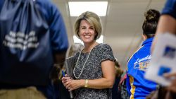 Photo of teacher in crowded high school hallway