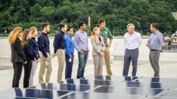 Sustainability science students with professor doing hands-on work with photovoltaic solar cells