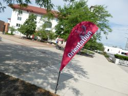 A flag-banner from a recent Orienation outside of the Student Center.