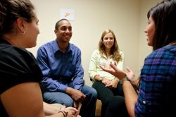 Photo of students smiling during counseling sessions