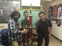 from left: Albert Jarvis, Hanon Zatloff and Brian Giraldo holding their Quiz Bowl trophy